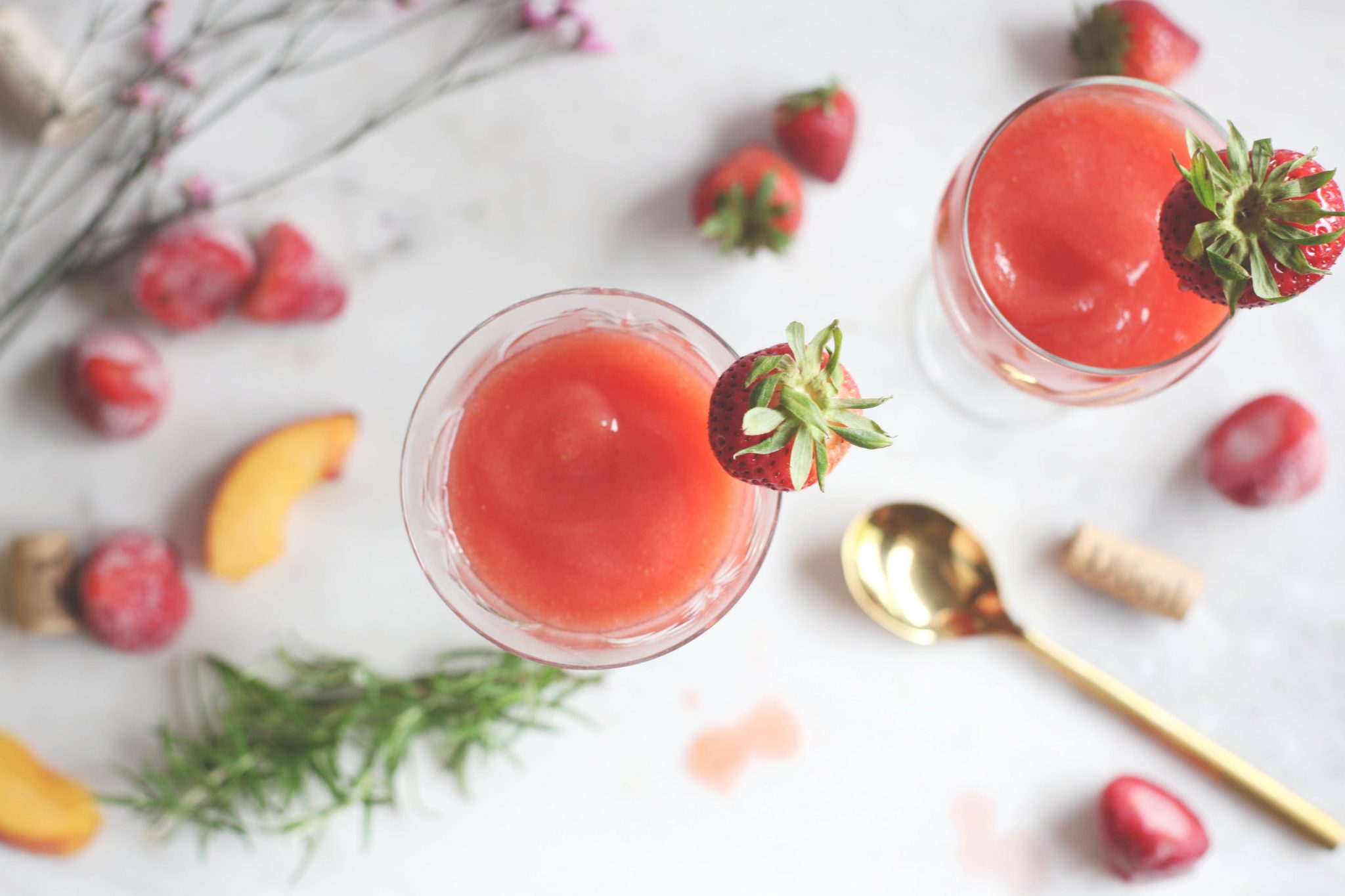 PEACH AND STRAWBERRY FROSÉ WITH ROSEMARY SIMPLE SYRUP - Tastemaker Blog