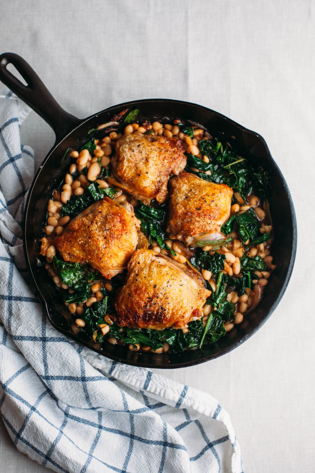 Crispy Chicken Thighs with Greens and Beans - Tastemaker Blog